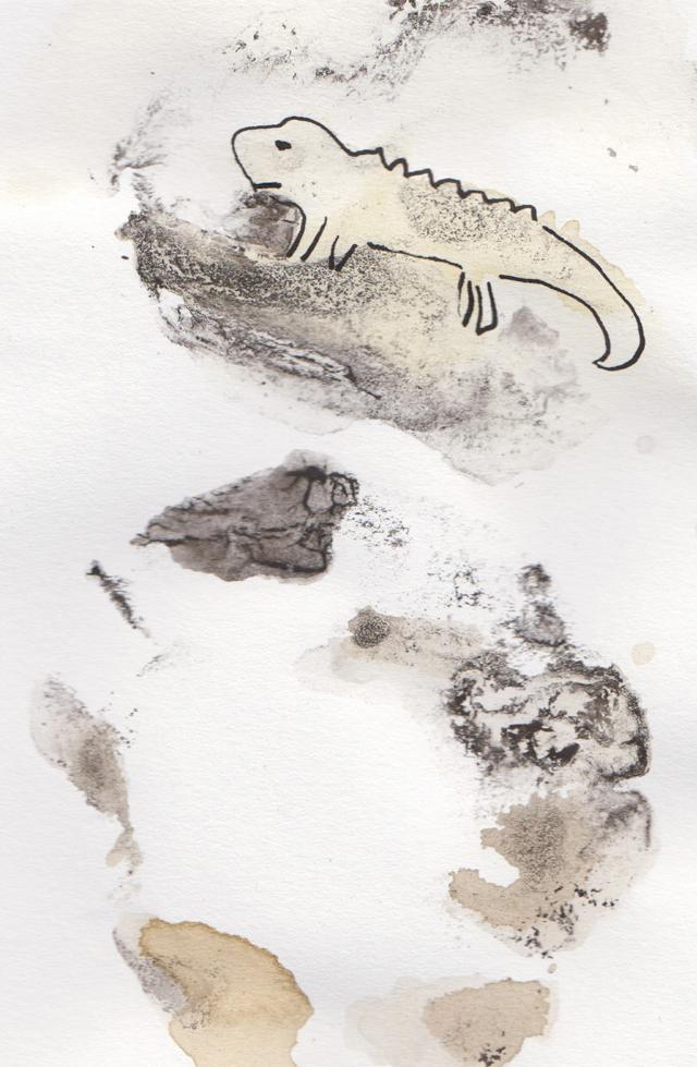 getekend reptiel van inkt en thee